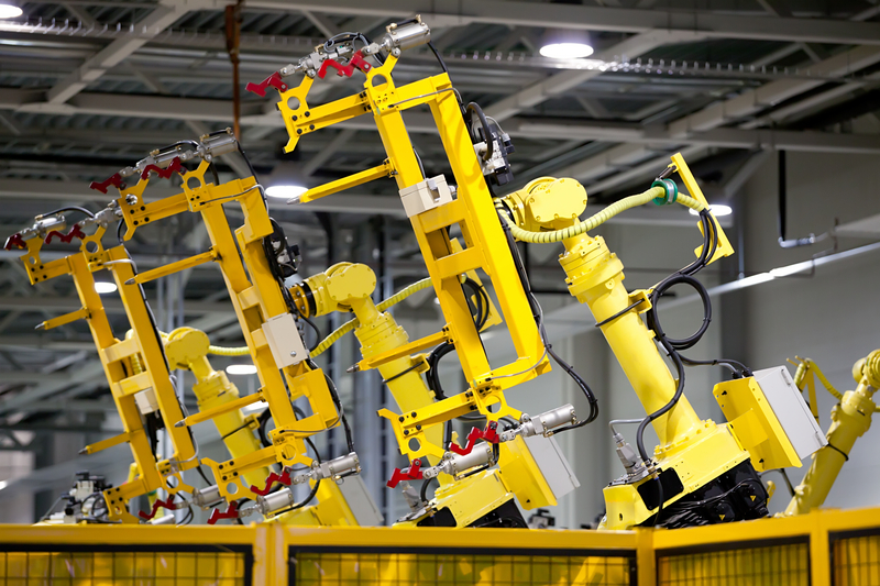 Robot arms protected from overspray by Wearlon 4545.76